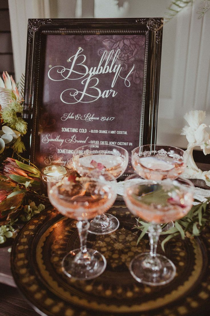 Custom designed bar signage with one of our italian trays and our gorgeous etched champagne coupes.