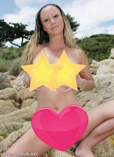 naked on a public rocky beach