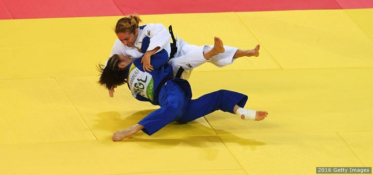Angelica Delgado (white) and Tsolmon Adiyasambuu of Mongolia (blue) compete in the women's -52kg elimination round at the Rio 2016 Olympic Games at Carioca Arena 2 on Aug. 7, 2016 in Rio de Janeiro. - The Best Photos From Rio 2016: Aug. 7 Edition