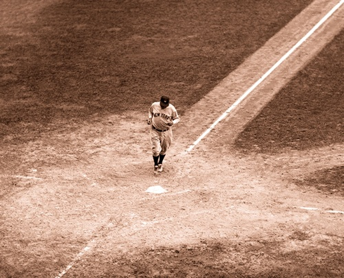 Babe Ruth hitting home plate