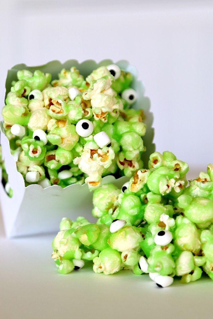 Munch on Monster Slime Popcorn! Recipe for ooey gooey green slime popcorn covered in eyeballs, so fun for a monster birthday party.