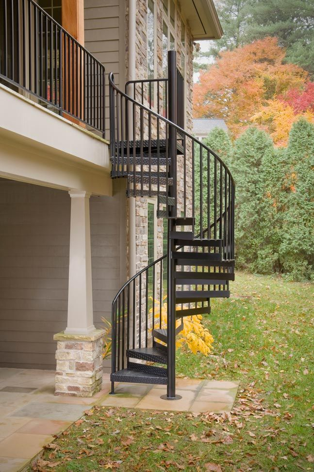 """5' 0"""" Diameter CODE Custom Welded Aluminum Stair with included triple in-between spindles, optional diamond plate lip-up design treads, balcony landing rail and black powder coat finish. www.theironshop.com"""