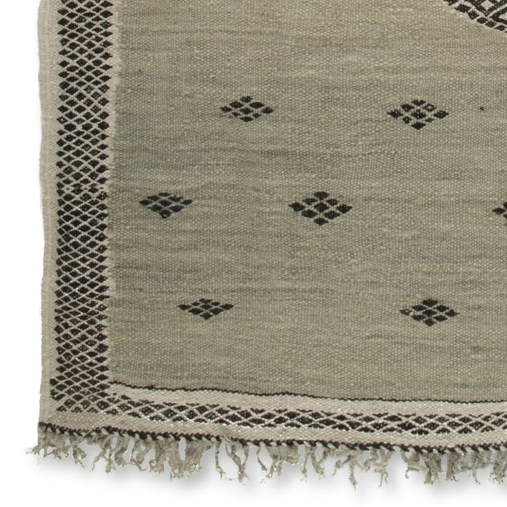 Handwoven carpet made in the High Atlas of Morocco by a women cooperation. Fairtrade and 100% wool. www.fair-fabrics.nl