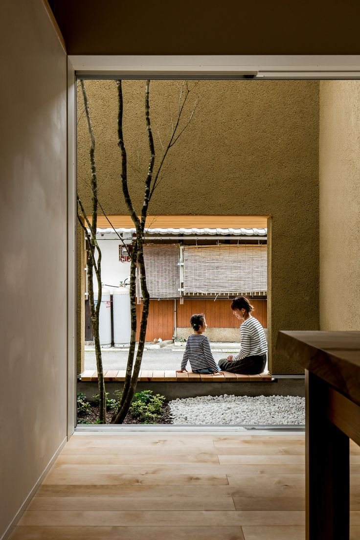 The tall rough rendered walls around the garden provide the residents with privacy from the street, with two openings that offer natural ventilation.