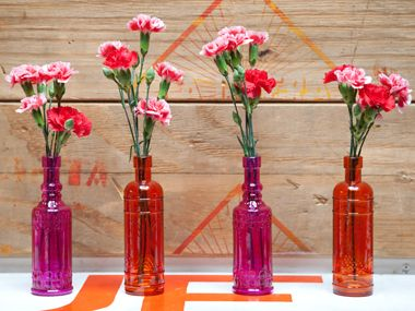 I love these bright, cheap bottles for centerpiece ideas with flowers... http://www.lunabazaar.com