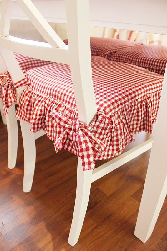 Wonderful cozy red gingham seat cushions add such charm to these chairs!
