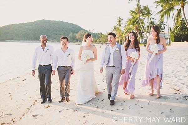 InAsia Wedding Thailand, Koh Samui beach villa wedding, bridal party walking with bride and groom on the beach, destination beach wedding