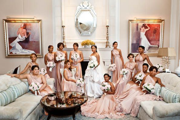 """""""essence.com's The 2012 Bridal Bliss Awards"""" The Most Fabulous Bridesmaid Gowns:  Lovely bride Tinique chose these stunning Grecian-inspired, pale pink bridal gowns from Two Birds for her beautiful bunch of bridesmaids. The gowns are unique because one style can be worn 15 fabulous different ways."""