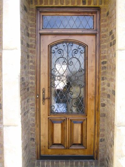 Old world style wood and iron front door with transom for Old world entry doors