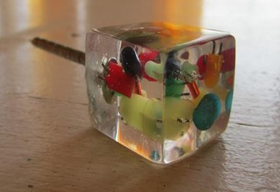 Custom resin drawer pulls.  I thought quick set epoxy and some fun objects would be awesome as drawer pulls!