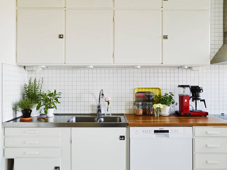 Dream kitchen: built-in cupboards/cabinets and wooden counter. Minimalist, yet warm. And those tiles!