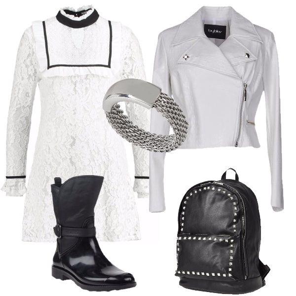 Outfit composto da un vestito in pizzo bianco con colletto alla coreana con sopra in abbinamento un giubbotto bianco, modello biker, con zip. Le scarpe sono degli stivaletti neri in ecopelle, la borsa è uno zaino nero con applicazioni in metallo e l'anello è in acciaio inox. Consiglio in questo periodo di completare il look con dei collant neri coprenti e di indossare una pelliccia senza maniche sopra il giubbotto.