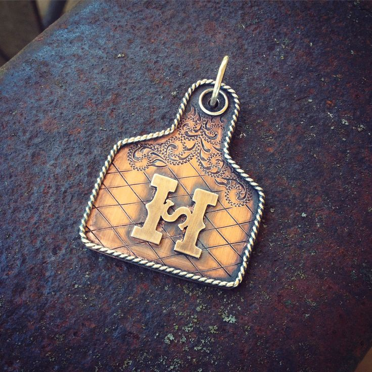 Engraved Ear Tag pendant by Silo Silver
