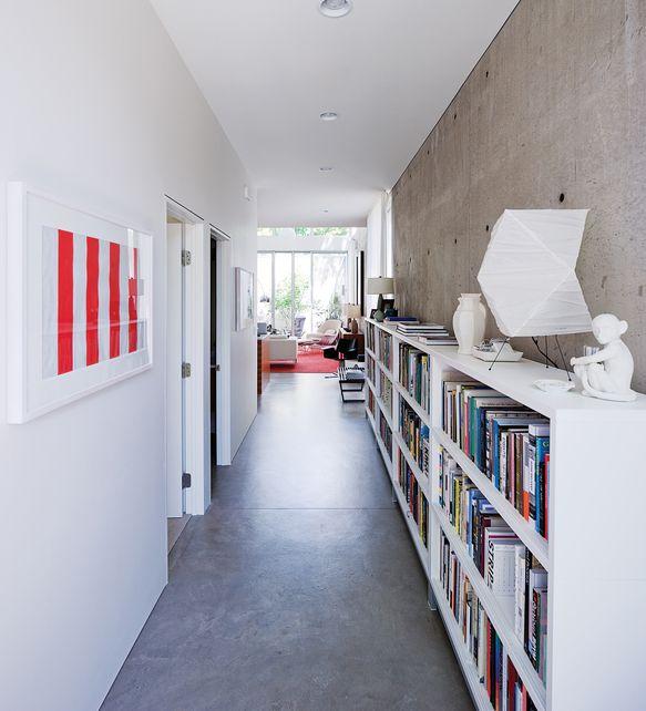 long, low bookshelf in hallway