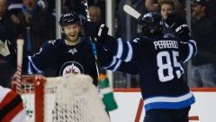 Nov. 18 2017 - Jets use second-period barrage to beat Devils The Winnipeg Jets scored a trio of goals in a span of 95 seconds in the second period and went on to defeat the New Jersey Devils 5-2 on Saturday afternoon. Connor Hellebuyck made 34 saves in the Jets (12-4-3) fourth straight victory. The goalie has allowed two or less goals in 11 of his 14 starts (11-1-2).Joel Armia, Mathieu Perreault , The Canadian Press