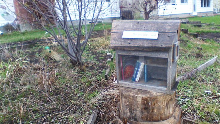 """Andreas Berko. Calgary, Alberta, Canada.   Our Little Free Library is made out of reclaimed wood from a fence that was taken out north of Edmonton, somewhere near Thorhild, Alberta. It was lovingly crafted by Jerry, our children's """"Poppa""""."""