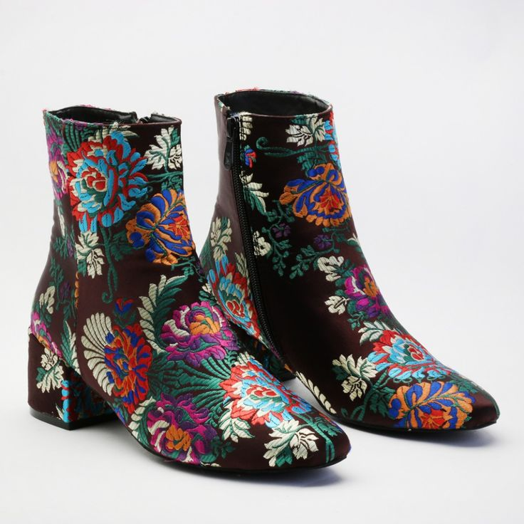 The perfect autumnal booties for you wardrobe. These boots nail the over the top granny's attic trend that's all over the catwalks at the moment. Featuring floral embroidery with a rounded toe and mid heel. Pair these with the craziest combos imaginable....frayed kick flare jeans with printed bomber and bold coloured knitwear! Think big!  Heel Height: 2.5\