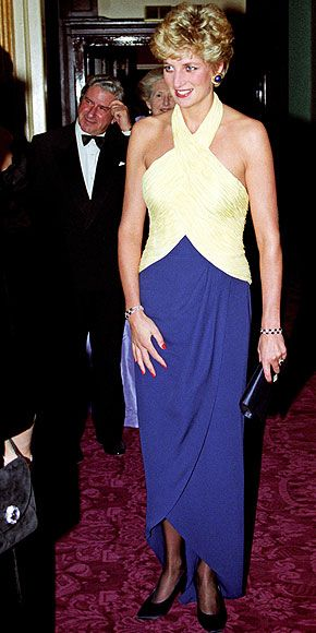 People:  THE CHIC YEARS: 1992-1997 photo | Wearing a distinctive halter gown, Diana dared to be bold with color at a 1992 Royal Opera performance.  Credit: PA Photos/Landov