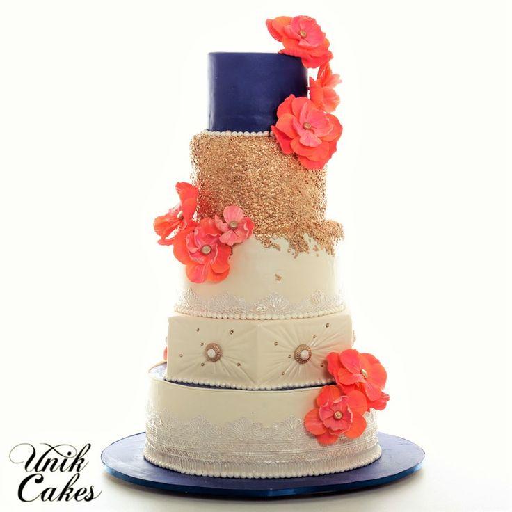 Gold, sunset orange and navy blue wedding cake.