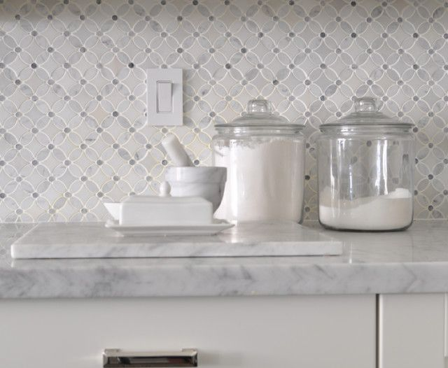 backsplash ideas-- Meredith Heron Design: Carrara marble countertops pair with a backsplash created from a mix of Oriental White ...