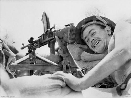 September 1941 - a Soldier from the 2/23rd Infantry Battalion beside his Bren light machinegun at the frontline in Tobruk