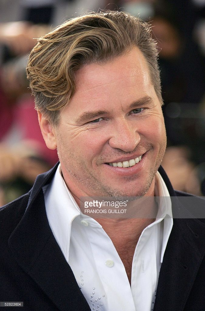 US actor Val Kilmer smiles during a photo call for US director Shane Black's film 'Kiss Kiss Bang Bang', 14 May 2005 at the 58th edition of the Cannes International Film Festival. The film is being shown out of competition. The Cannes film festival, the world's top showcase of cinema, started 11 May with a slew of veteran auteurs lining up for the prestigious Palme d'Or prize, and Hollywood muscling in to promote this year's blockbusters.