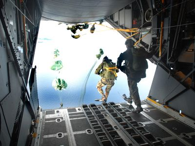 Pararescuemen Perform a Static-line Jump Out of a C-130 Hercules