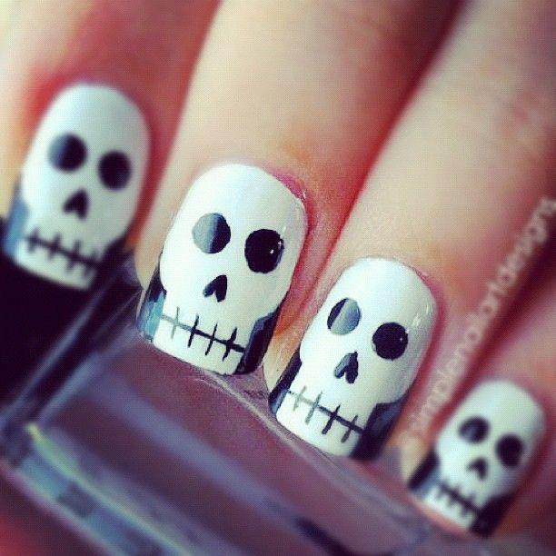 Photo by fabshion: Halloween skull nails by @simplenailartdesigns . Fab or drab? how to: 1)With black, add a curved and vertical line on both sides to make the shape of a skull. 2)Add a horizontal line and small vertical lines for the mouth. 3)Add 2 large dots for the eye socket. 4)Add an upside down heart for the nose.