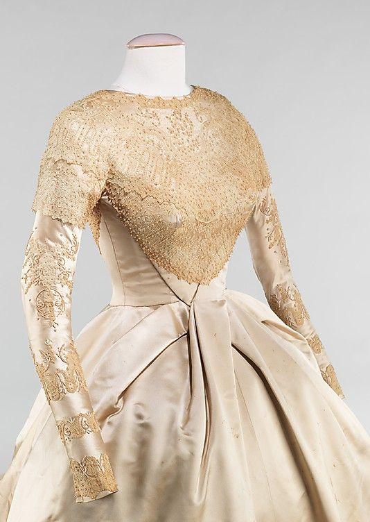 Wedding Dress.  Kathryn Kuhn (American).  Date: 1960. Culture: American. Medium: silk, pearl, synthetic. Dimensions: Length at CB (a): 199 in. (505.5 cm). Length at CB (b): 47 in. (119.4 cm).