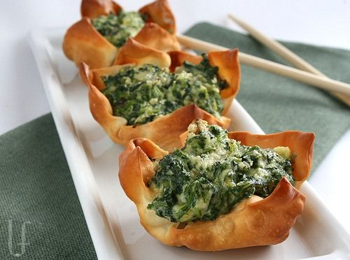 Ricotta Spinach Cups Appetizers - pretty little bites.  Pre-bake the wrappers and store them in an airtight container once cooled. Make the filling and chill in the fridge until ready to serve.  Perfect served either hot or room temperature.