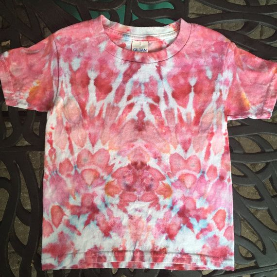 This is a vibrant hand-dyed t-shirt for kids! Use your imagination to find interesting images in the design. This one of a kind ice dyed item is unique and a great gift for one of the young ones in your life! Colour- Pink, White Size- 4T Toddler Brand- Gildan  It is a one of a kind hand made item created with the ice dye technique. Ice is used to deposit professional quality dye onto the fabric and the abstract art is created over a period of 24 hours. This item has been pre-shrunk in a hot…