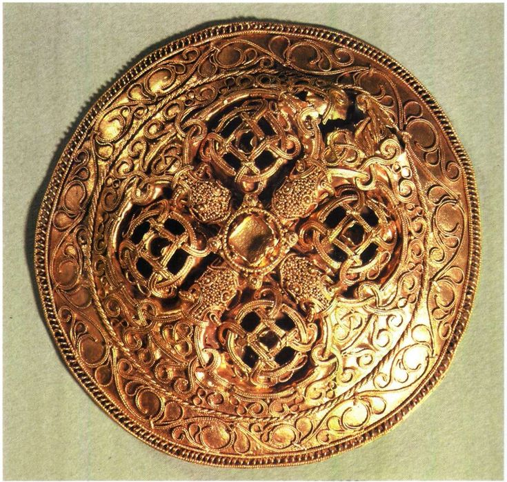 The Hoard From Hornelund  --  Discovered near Varde  --  2nd Half 10th Century  --  Danish  --  Contains two clothes brooches & an arm ring of gold.  The two brooches are the finest from the Danish Viking Age.