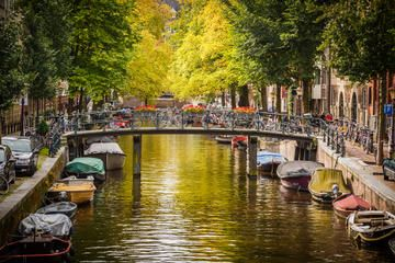 """Step aboard a glass-topped sightseeing boat with this 1-hour Amsterdam canal cruise, and see the city sights by water. Simply reserve your preferred time at the excursion office before you cruise, and then bypass the lines at the pier. Then, cruise along the city's UNESCO World Heritage-listed canals to see the """"skinny bridge"""" of Magere Brug, the affluent Golden Bend district, the Anne Frank House and more, as you learn about Amsterdam's history from an audio guide. From USD $17.93"""