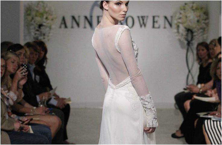 Anne Bowen's gown has a low-cut back with mesh detail and beaded sleeve design