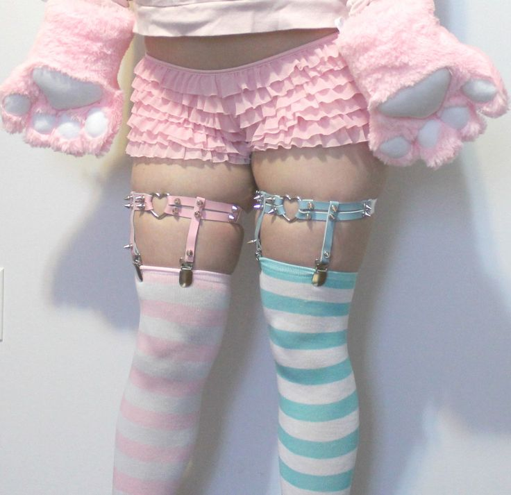 Hmm those just might be a set of the Victorian style of leg garters made modern. Leather and fully adjustable.