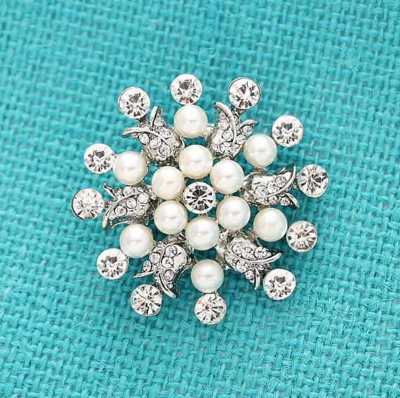 Dazzling crystal pearl brooch jewelry, which can be used for your DIY project - Vintage wedding, bridal brooch bouquet, ring pillow, invitations, cake decorations, event decor, crafts, scrap booking and much more!  Size: 1 1/2 inch wide 1 1/2 inches high Pearl color: Ivory Stone color: Crystal clear Metal: Silver  More SILVER brooches - https://www.etsy.com/shop/Crystalitzy?section_id=16136267&ref=shopsection_leftnav_1  Please note that this rhines...