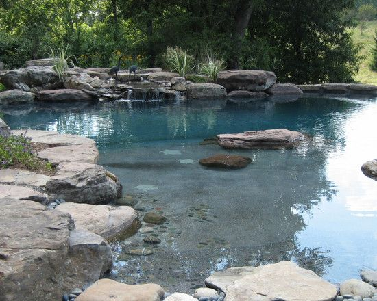 Swimming pool with the look of a natural pond..one of my faves.