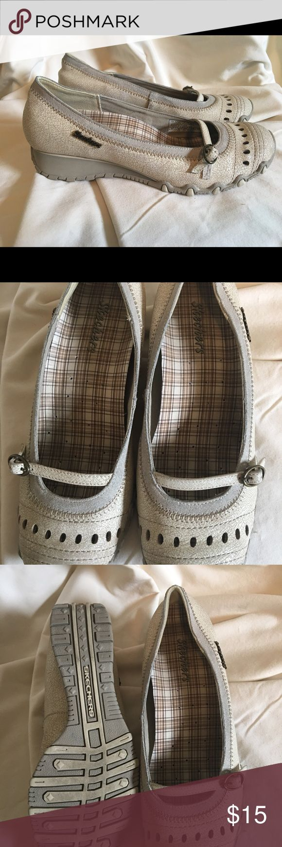 ladies Skechers slip on EUC worn less than a handful of times! Super cute slip on with a very slight heel. Color is a distressed taupe. Gold Skechers emblem on the side. Memory foam soles Skechers Shoes Flats & Loafers