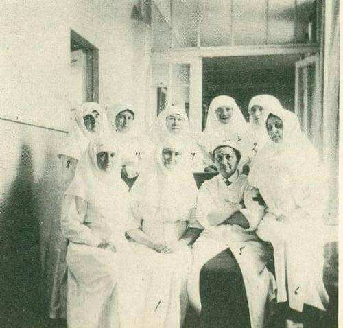 Empress Alexandra Feodorovna of Russia and the Grand Duchesses Olga and Tatiana Nikolaevna Romanova of Russia with Princess Vera Gendroitz and a few of the nurses from their hospital at Tsarskoe Selo,1915.