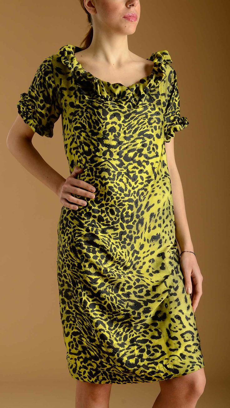 DAMADEI Animalier printed tunic dress in acid green characterized by all over strass detail, short sleeves, wide boat neck, rouche detail on the neck and on the sleeves, two welt pockets at front, 98% polyester 2% elastan.