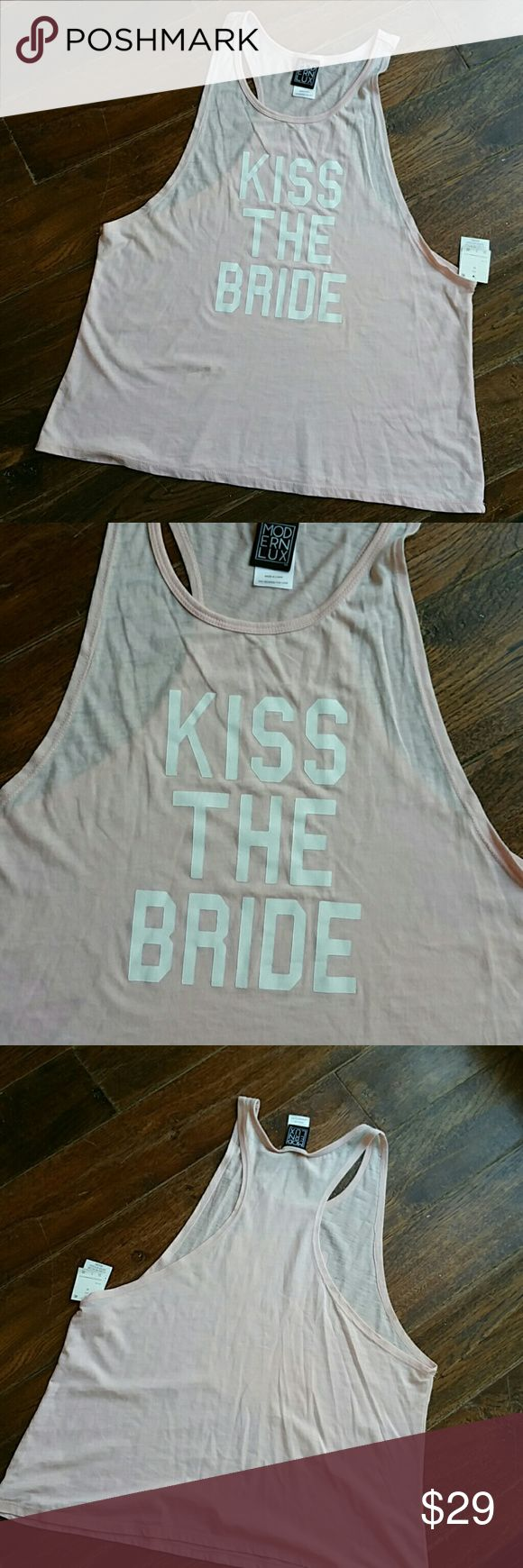 KISS THE BRIDE PINK TANK TOP This is a really cute Razorback pink tank top that says kiss the bride would be a great gift for bridal shower or Bachelorette night new with tags excellent condition I also carry this in a medium Modern Lux Tops