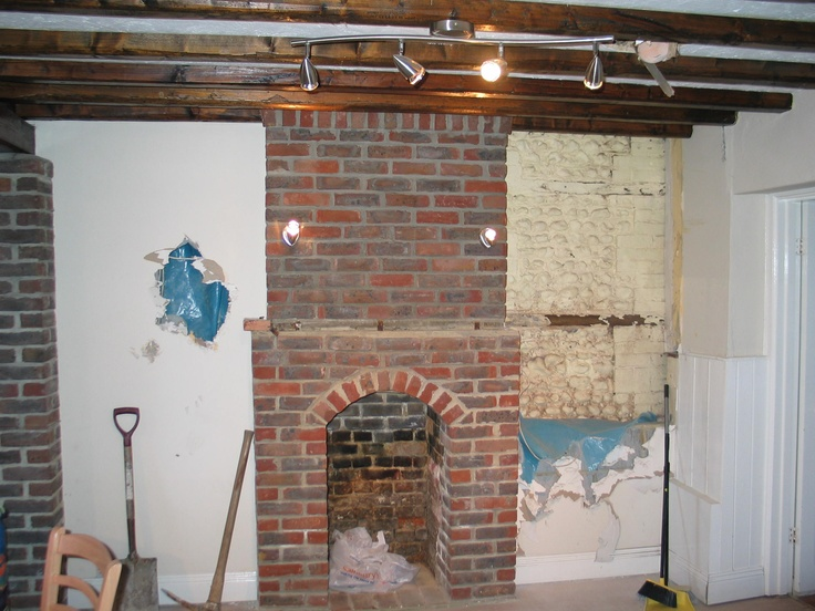 Modern brick fireplace removed. These were engineering bricks, ridiculously hard to break out! This will be replaced with a break front glass display cabinet adding both light and interest to a dark corner.  #restoration #england #georgian #fireplace #beams #renovation #historic #arundel #littlehampton #westsussex #townhouse