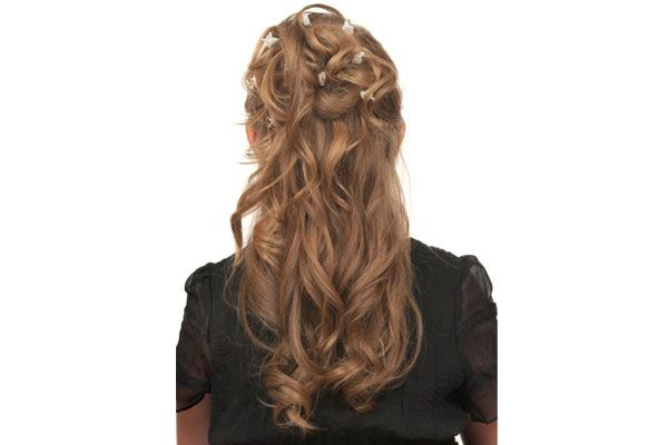 An easy half updo for prom is to pin up curls with cute barrettes!