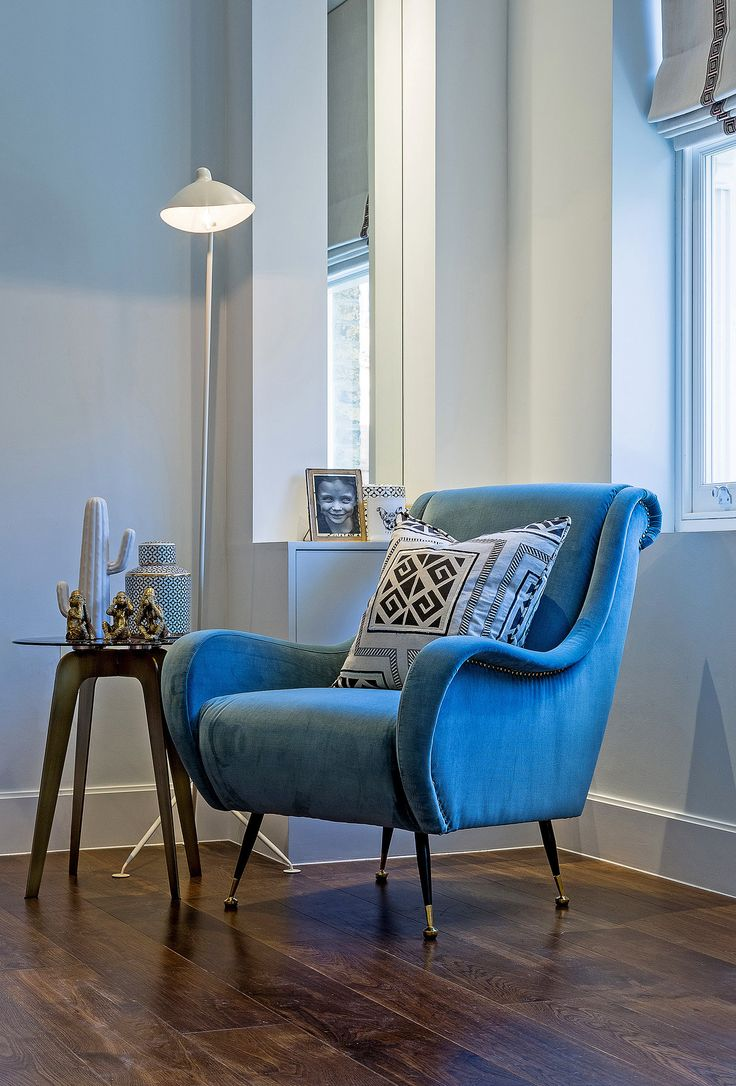 This elegant Eichholtz chair in striking turquoise fabric oozes quirky, mid-20th century style, the antique brass nail trim perfectly complementing the RV Astley Vottera antique brass accent side table with smoked glass top.