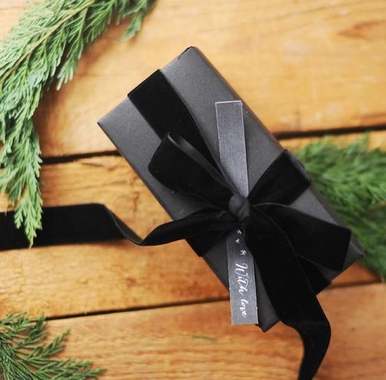 Elegant wrap - black matte paper (construction paper maybe?) and either black velvet ribbon or shiny satin ribbon