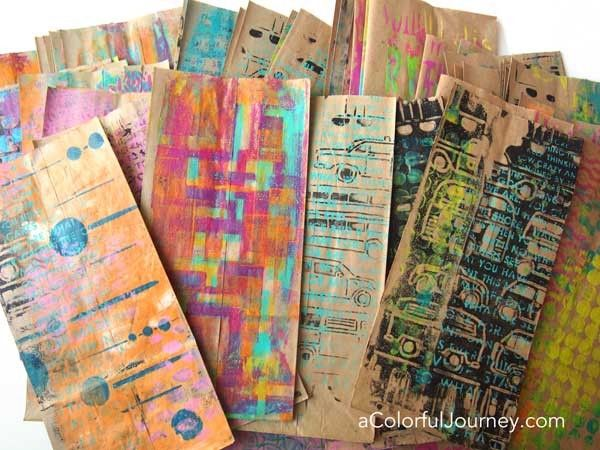 A Gelli Plate® and stencils make plain brown bags colorful goodie bags
