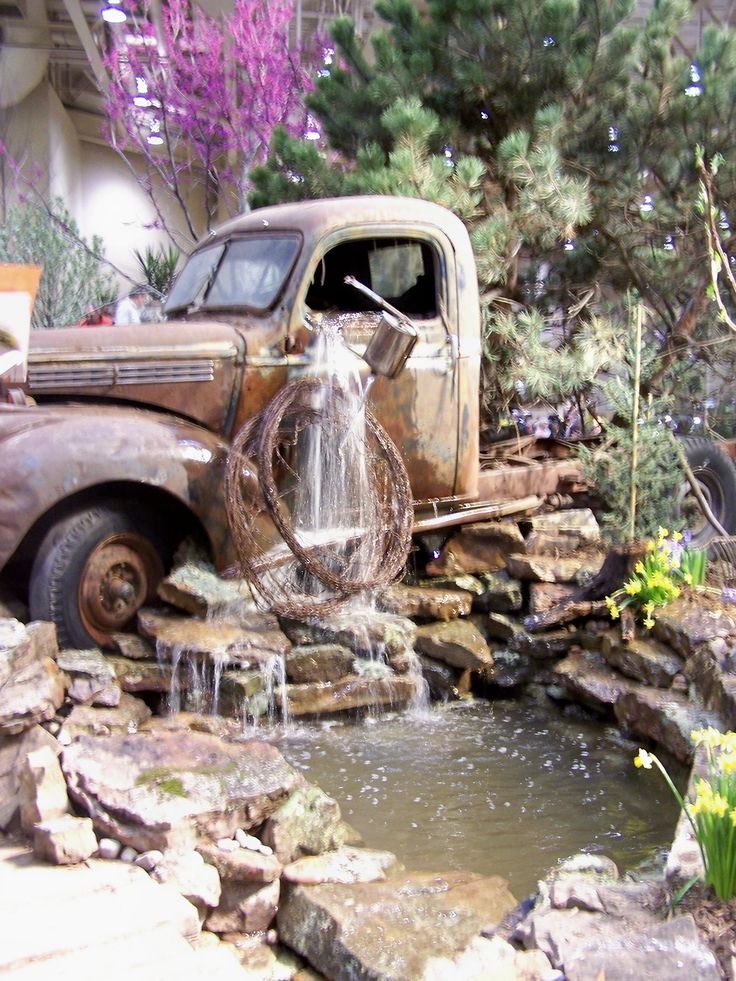 Try something unique use an old rusty car or truck for a for Garden fountains and water features