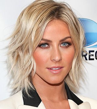 Julianne Hough's loose waves and platinum blonde end hair style looks great. Not so convinced about the clashing orange face...