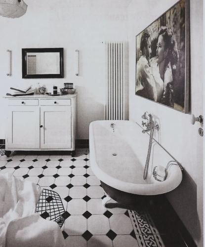 Retro bathroom with black and white octagonal tiles.
