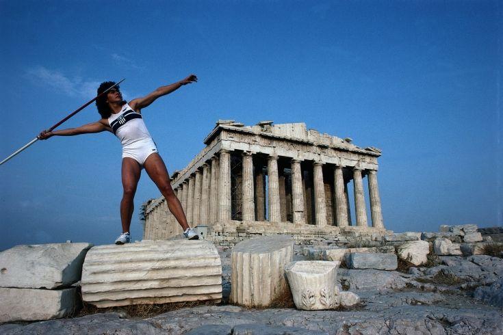 Neil Leifer's 1984 Olympic Odyssey Around the World // Sophia Sakorafa poses with javelin in front of the Parthenon